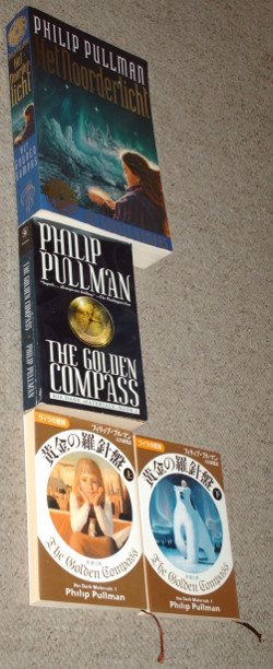 """His Dark Materials"" book 1 in Dutch, English and Japanese."