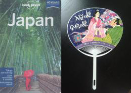 Lonely Planet Japan and fan.